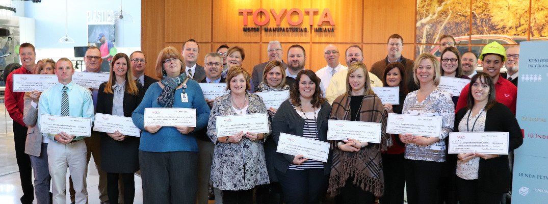 People Holding Ceremonial Check for the STEM Grants from the Toyota USA Foundation
