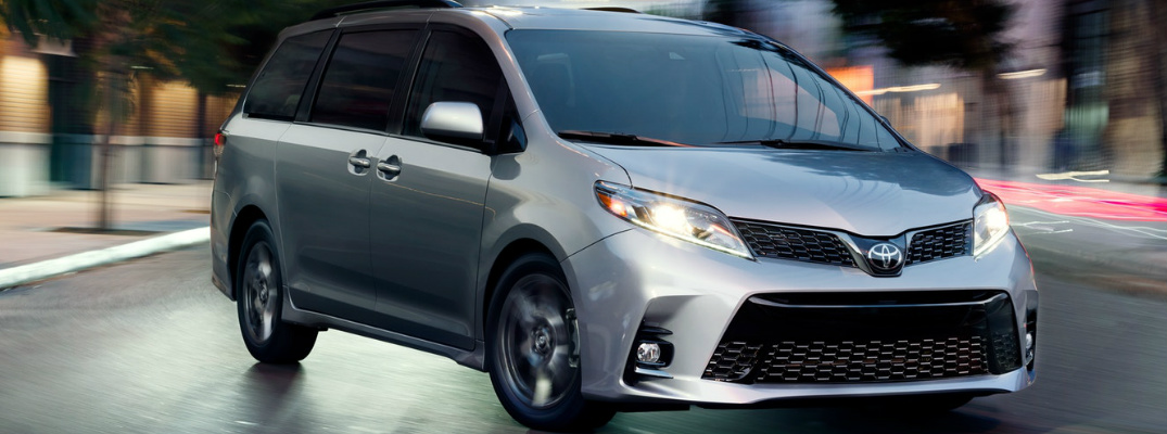 Silver 2019 Toyota Sienna Driving on a City Street at Night