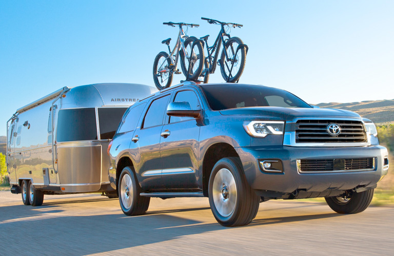Dark Grey 2019 Toyota Sequoia Towing a Camping Trailer
