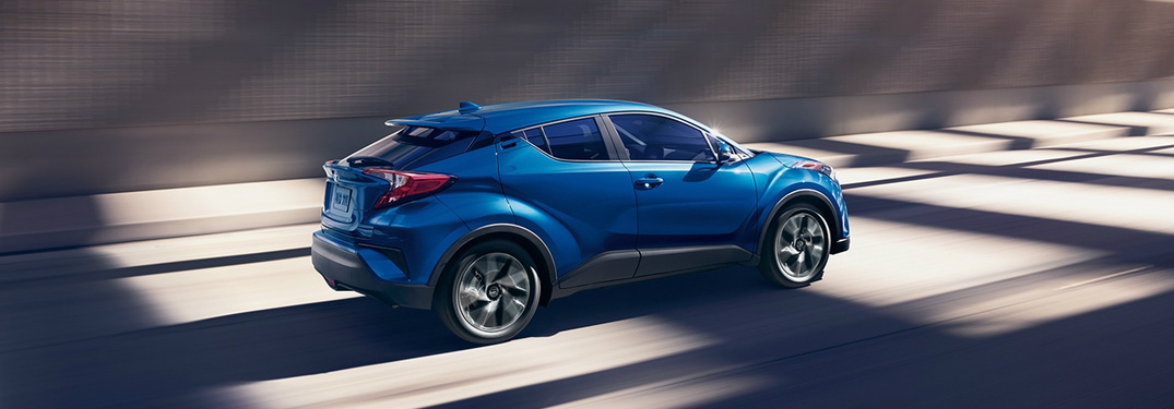 blue 2018 Toyota C-HR driving through tunnel exterior side view