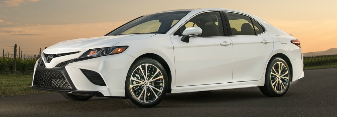 white 2018 Toyota Camry at sunset exterior front driver side view