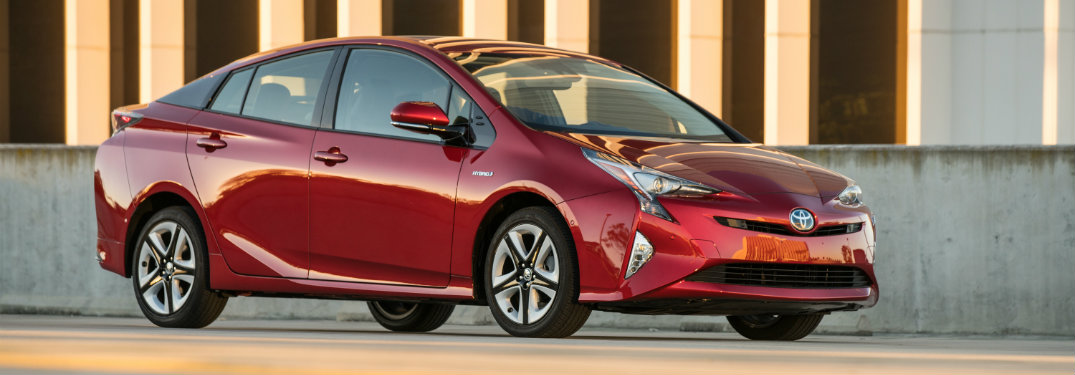 Red Toyota Prius parked