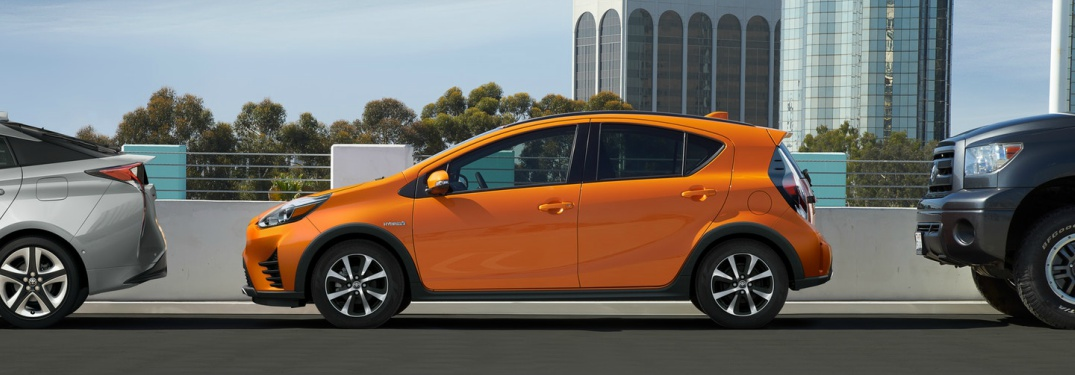 orange 2018 Toyota Prius c side view