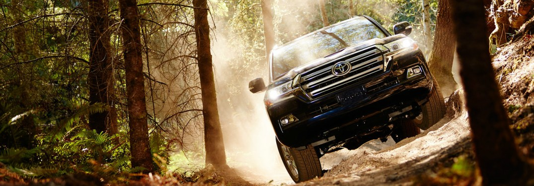 black 2018 Toyota Land Cruiser driving off-road