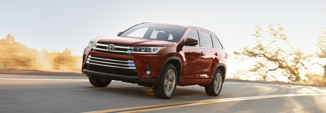 red 2018 Toyota Highlander front side view