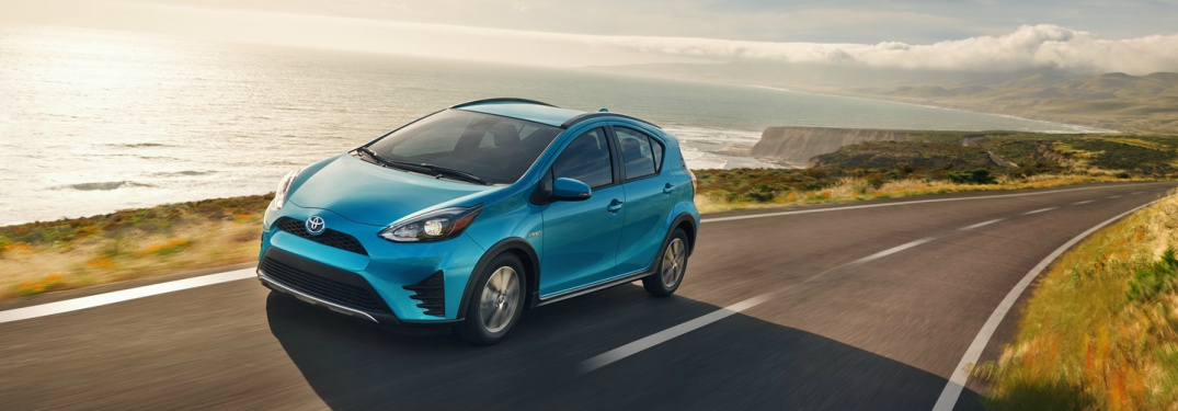 blue 2018 Toyota Prius c front side view