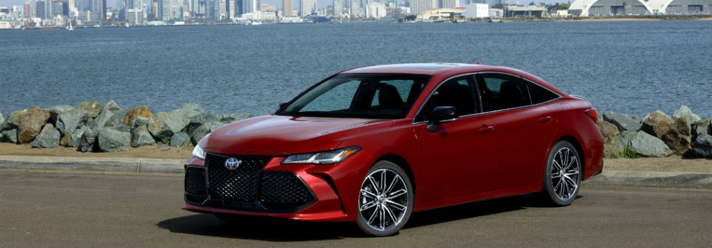 Toyota Avalon Exterior Front Fascia And Drivers Side Parked In Front Of Water And City O X