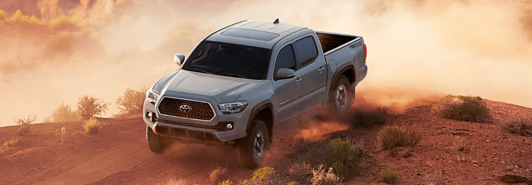 2018 Toyota Tacoma exterior front fascia and drivers side on dirt road