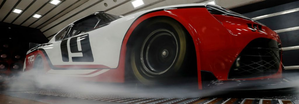 When will the 2019 Toyota Supra be seen on the racetrack?