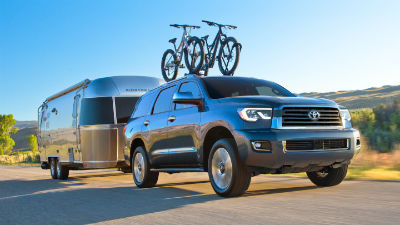 2019 Toyota Sequoia exterior front fascia and passenger side pulling trailer with bikes on top