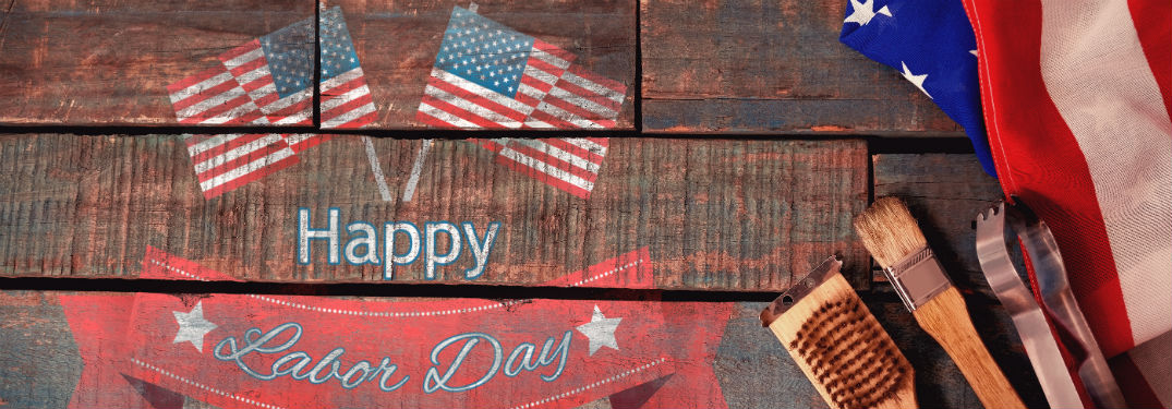 Happy Labor Day text on banner with 3 flags and tools