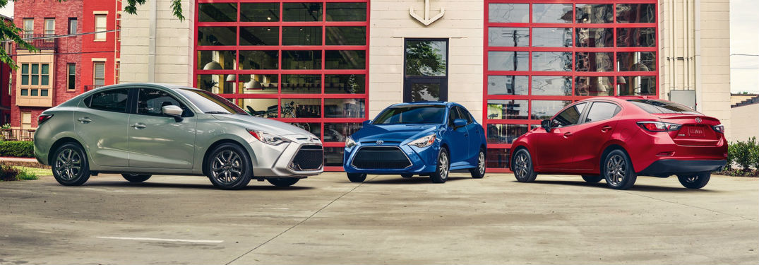 2019 Toyota Yaris 3 vehicles exterior 2 front fascia 1 back fascia in front of building