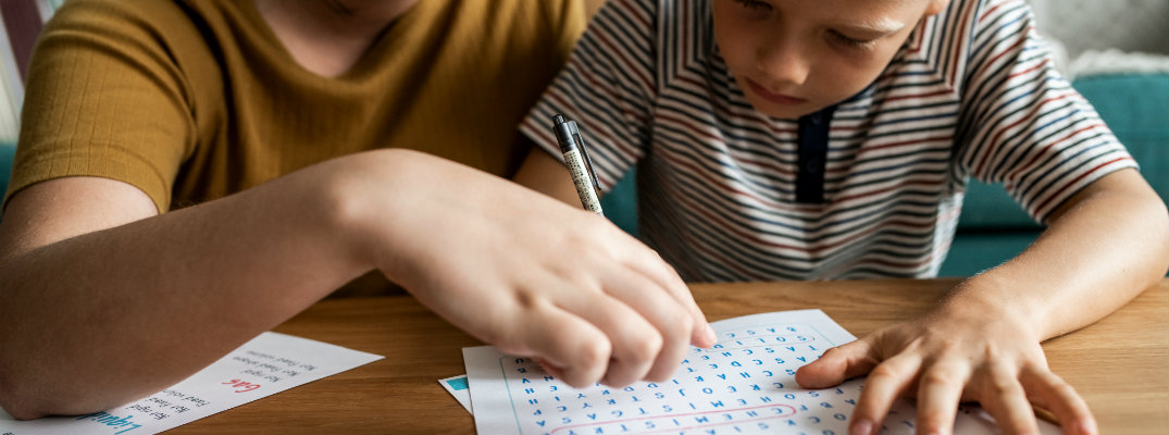 parent helping child with word search