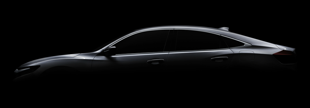 Black background with a grey outline of the Honda Insight prototype