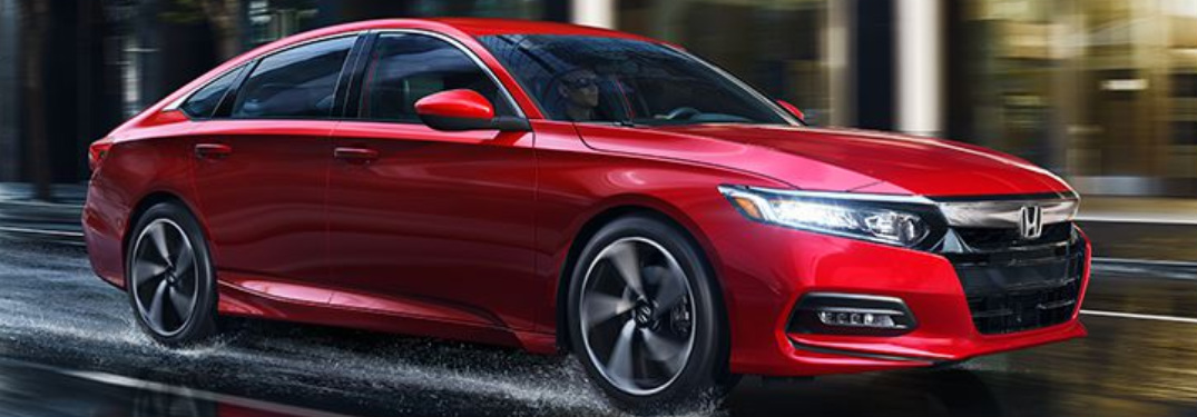 2018 Honda Accord in red driving in the rain