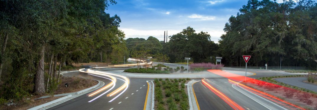 A roundabout with blurred traffic going through it
