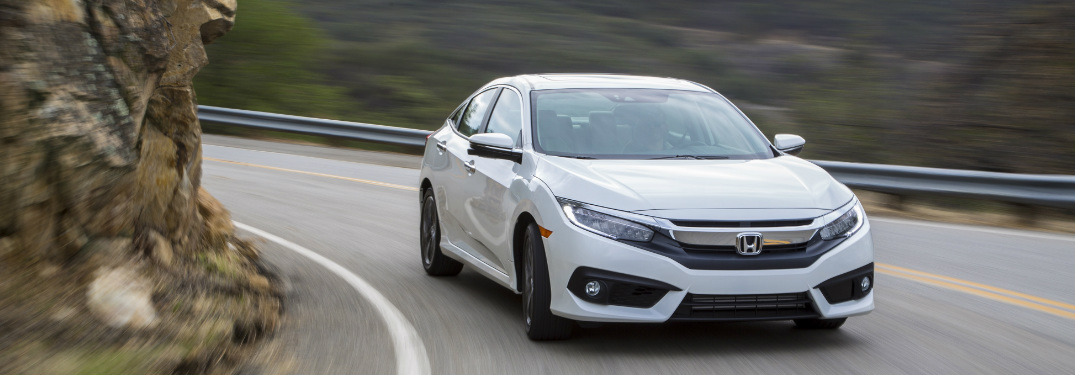2018 Honda Civic Sedan in white rounding a mountain corner