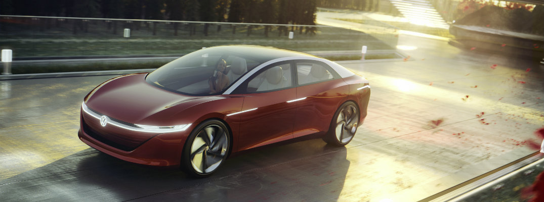 2018 VW I.D. Vizzion electric concept sedan driving on private home road with fall sunset