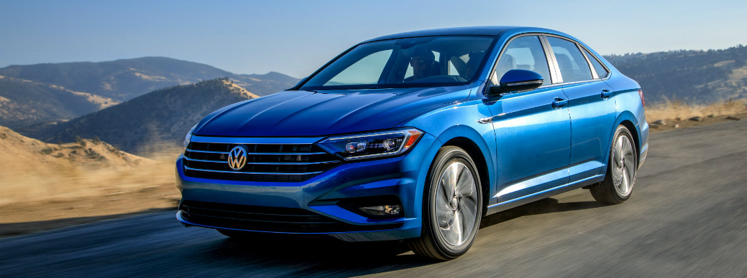 2019 Volkswagen Jetta driving through the desert wilderness on an empty highway