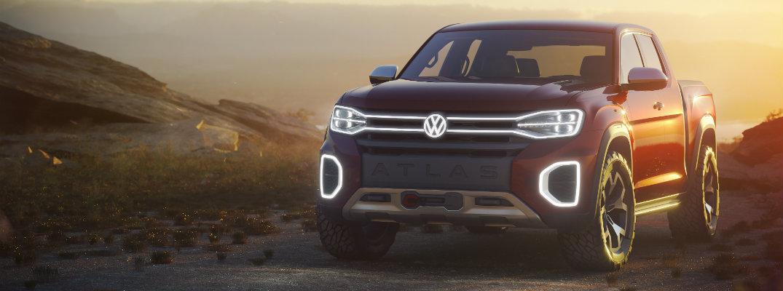 Volkswagen Atlas Tanoak concept pickup truck exterior front grille, fascia, and bumper shot at sunset overcast