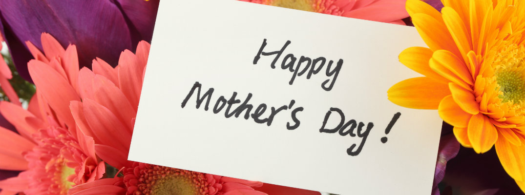 happy mother's day card surrounded by colorful orange, yellow, pink, and purple flowers bouquet