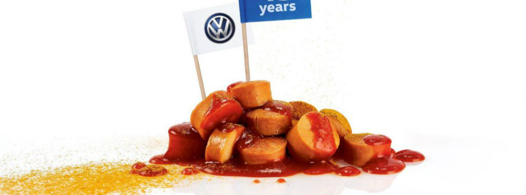 Volkswagen sausage seasoned with spice and dipped in ketched with VW and 45 years flag planted