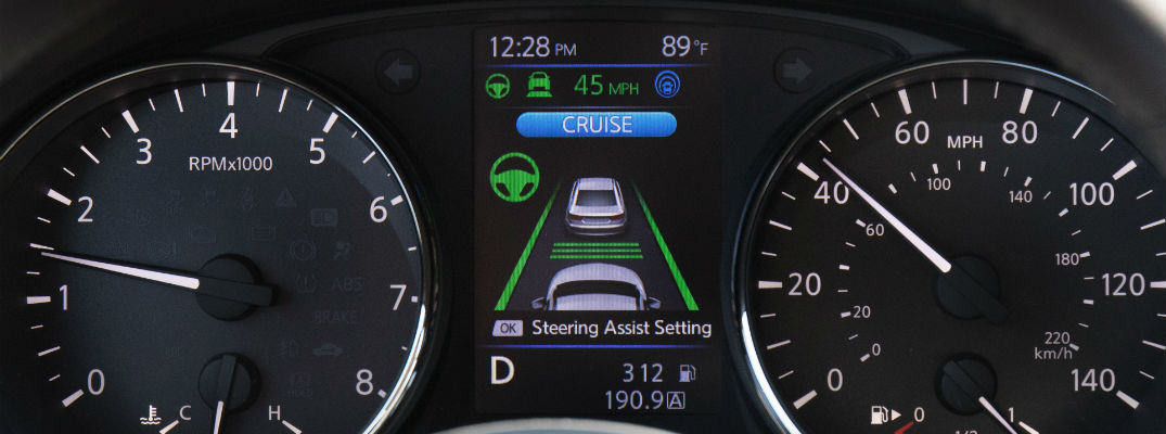 A photo of the center-mounted LCD screen showing the Nissan ProPILOT system.