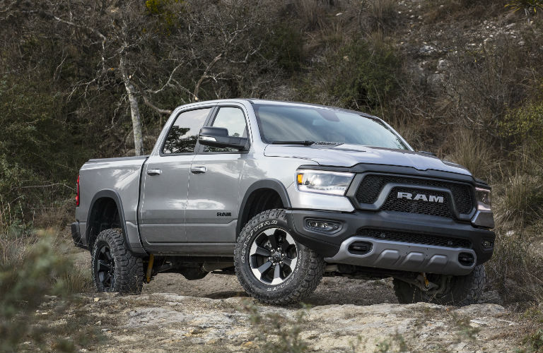 A front right photo of the 2019 Ram 15t00 parked on a gravel road