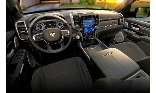 2019 Ram 1500 interior driver's seat view of front seating uphollstery, steering wheel, dashboard, and touchscreen infotainment