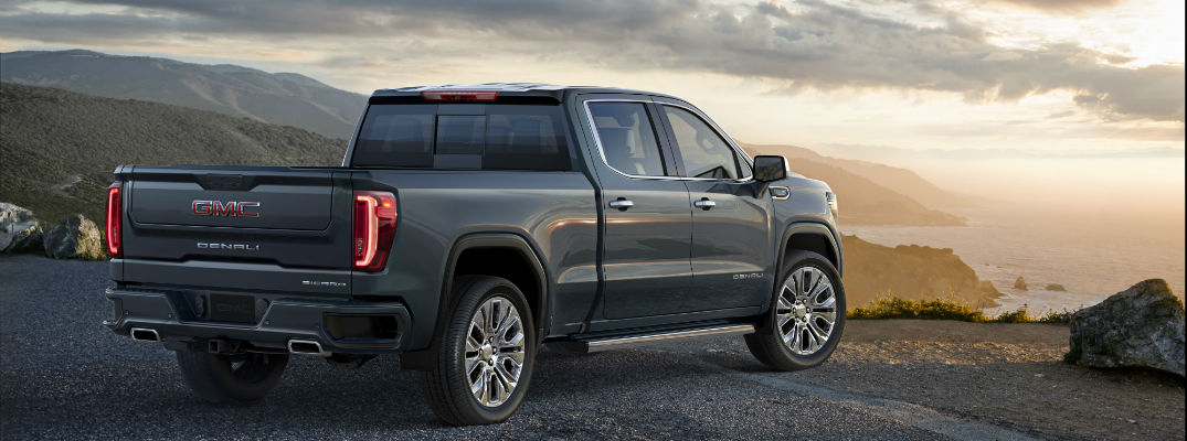 A rear right quarter image of the 2019 GMC Sierra looking over a bluff.