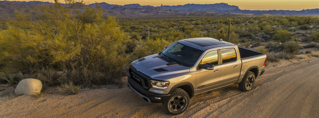 An overhead left profile photo of the 2019 Ram 1500 parked in the desert.