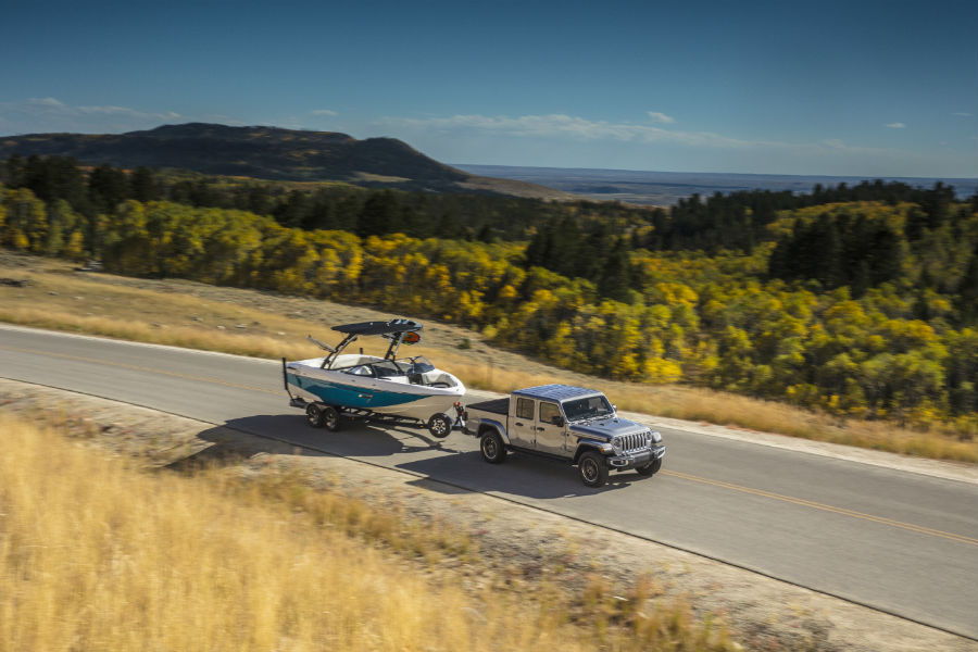 An overhead photo of the 2020 Jeep Gladiator towing a boat.