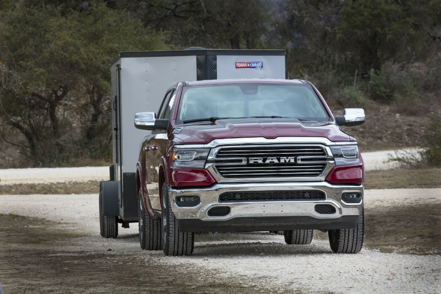 A front-end photo of the 2019 Ram 1500 pulling a large trailer.