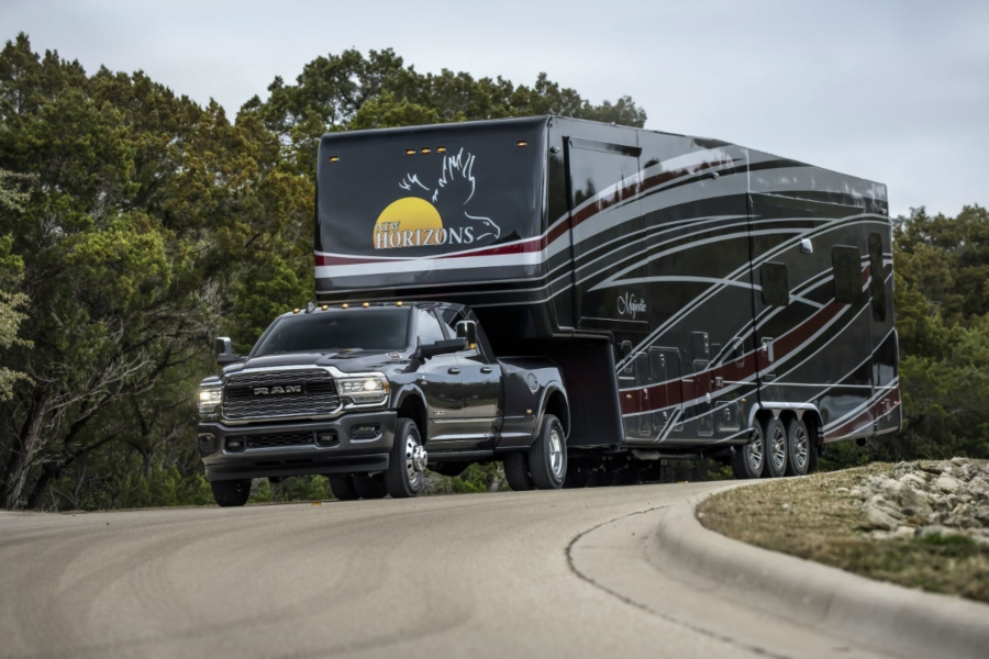 A photo of the 2019 Ram Heavy Duty pulling a large mobile home.