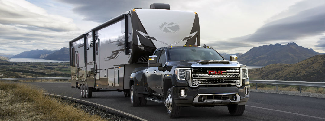 A photo of the 2019 GMC Sierra HD pulling a large motor home.
