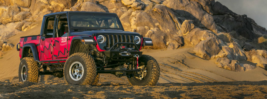 A front right quarter photo of the Jeep Gladiator parked in the desert.
