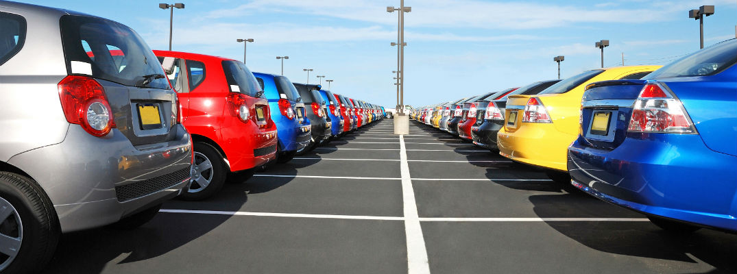 A stock photo of many vehicles parked on a sales lot.