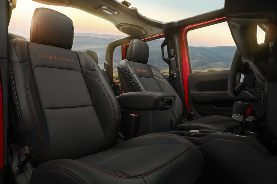 An interior photo of the front seats in the 2020 Jeep Gladiator.