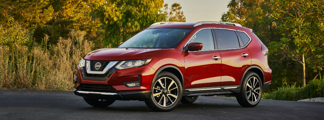 A left profile photo of the 2020 Nissan Rogue parked on the road.