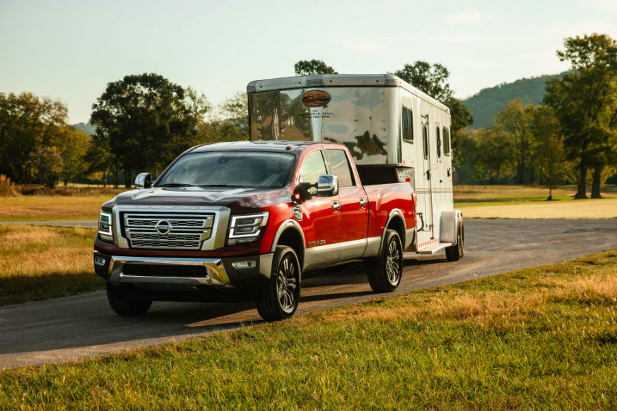 A photo of the 2020 Nissan Titan XD pulling a trailer.