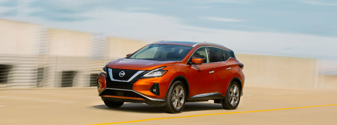 A left profile photo of the 2020 Nissan Murano in motion on the road.
