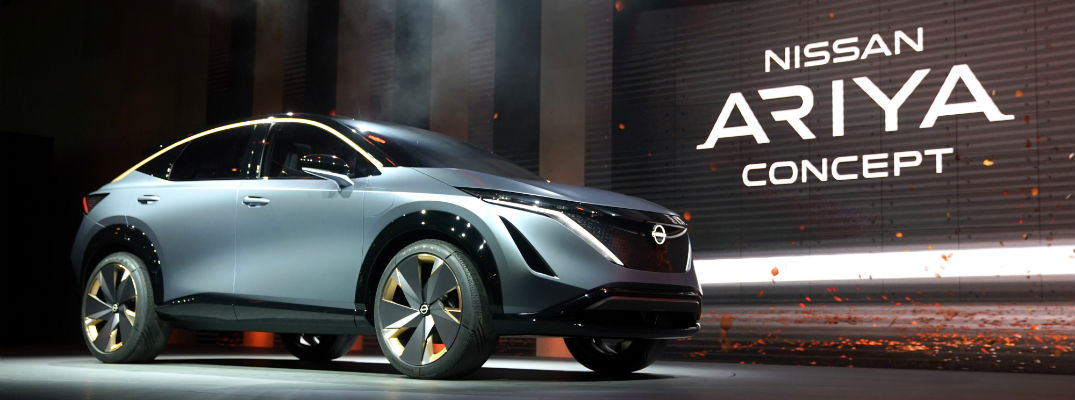 A photo of the Nissan Aryia Concept on stage at the Toyota Motor Show.