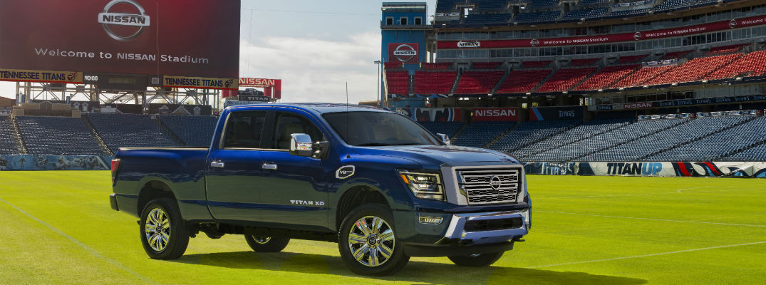 A photo of the 2020 Nissan Titan XD parked on a football field.
