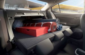 2020 Nissan Versa back seats folded down with items on top
