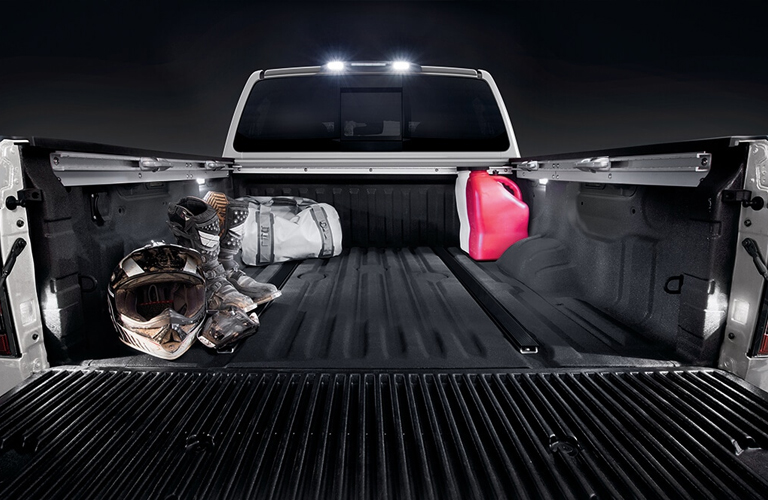 2020 Nissan TITAN open tailgate with items in the bed of the truck
