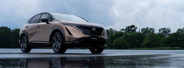 A photo of the Nissan Ariya on a splash pad.