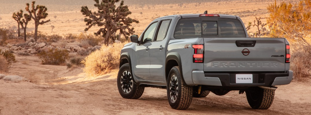 A rear left quarter photo of the 2022 Nissan Frontier.