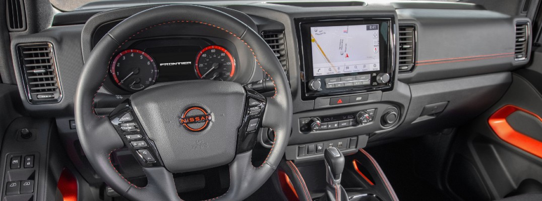 The driver's cockpit and dashboard in the 2022 Nissan Frontier.