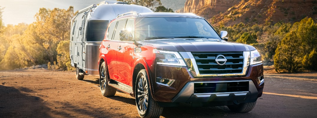 A 2021 Nissan Armada pulling an Airstream mobile home.