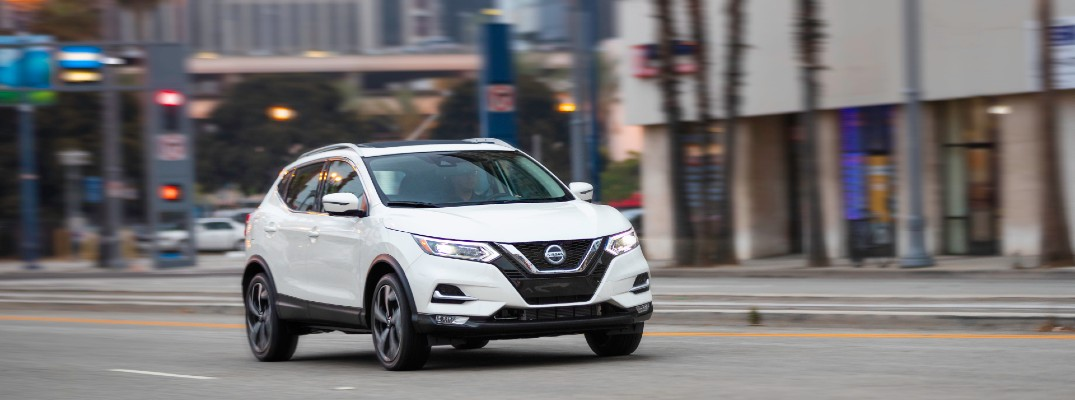The 2021 Nissan Rogue Sport on a city street.